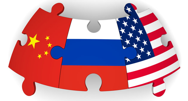 Puzzles with flags of the Russian Federation, China and the United States of America on a white surface. The concept of coincidence of interests in geopolitics. Isolated. 3D Illustration